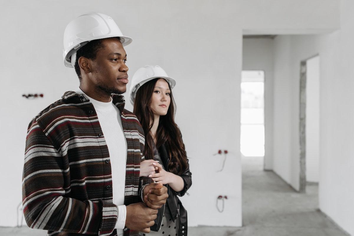 couple wearing a hard hat